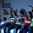 Group of young friends watching television at home of blacking-out — Stock Photo #43450575
