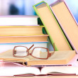 Composition with glasses and books, on table, on light background — Stock Photo #43452105