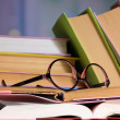 Composition with glasses and books, on table, on light background — Stock Photo #43452111
