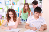 Group of young students sitting in class — Stock Photo