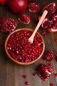 Ripe pomegranates on table close-up — Stock Photo