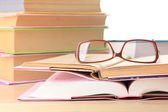 Složení s brýlemi a knihy, izolované na bílém — Stock fotografie