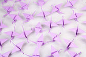 Origami cranes on wooden background — Stock Photo