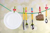 Tableware dried on rope on bright background — Stock Photo