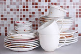 Dirty dishes on bright background — ストック写真