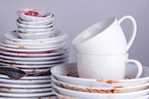 Dirty dishes on gray background — 图库照片