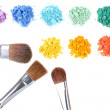 Rainbow crushed eyeshadow and professional make-up brush isolated on white — Stock Photo #43587305