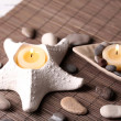Composition with spa stones, candles on bamboo mat background — Stock Photo #43589051