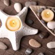 Composition with spa stones, candles on bamboo mat background — Stock Photo #43589059
