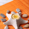 Composition with spa stones, candles on bamboo mat background — Stock Photo #43589083