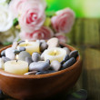 Composition with spa stones, candles  and flowers on  bright background — Stock Photo #43589151