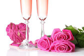 Composition with pink sparkle wine in glasses, and pink roses isolated on white — Foto Stock