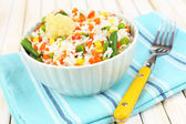 Cooked rice with vegetables on wooden table close up — Foto Stock