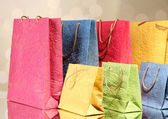 Colorful shopping bags, on  bright background — Stock Photo