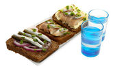 Composition with two glasses  of vodka, and  sandwiches wit salted fish, isolated on white — Stock Photo