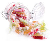 Tasty candies in jar isolated on white — Foto Stock