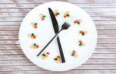 Medication schedule and meals. Conceptual photo. On wooden background — Stock Photo