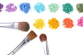 Rainbow crushed eyeshadow and professional make-up brush isolated on white — Stock Photo