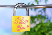 Padlock on bright background — Stock Photo