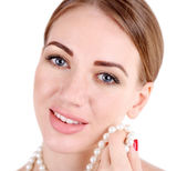 Portrait of pretty girl  with pearl beads on her neck isolated on white — Stock Photo