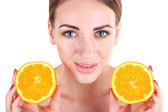 Beautiful young woman holding orange, isolated on white — Stock Photo