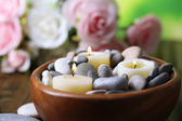 Composition with spa stones, candles  and flowers on  bright background — Stock Photo