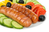 Grilled sausages with vegetables close up — Stock Photo