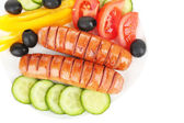 Grilled sausages with vegetables isolated on white — Stock Photo