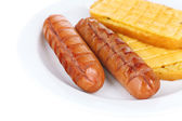 Grilled sausages with toasts close up — Stock Photo