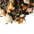 Heap of dry green tea isolated on white — Stock Photo