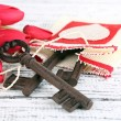 Key to love and happiness. Composition with key, decorative bag and flowers. Conceptual photo. On color wooden background — Stock Photo