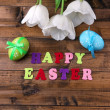 Composition with white tulips and Easter eggs on wooden background — Stock Photo