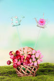 Metal decoration for flowers and bouquet in basket on natural background — Stock Photo