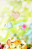 Spring composition on grass on natural background — Stock Photo