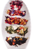 Different kinds of dry tea in dish close up — Foto Stock