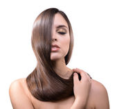 Beautiful young woman with long hair isolated on white — Stock Photo