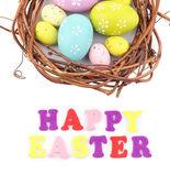 Uova di Pasqua in ghirlanda isolato su bianco — Foto Stock
