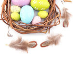 Easter eggs in wreath isolated on white — Stock Photo