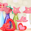Hand-made textile hearts and stars on wooden table, on light background — Stock Photo #43600355