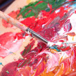 Paint, brushes and art palette close-up — Stock Photo