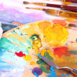 Artistic equipment: paint, brushes and art palette — Stock Photo #43604943