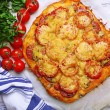 Homemade pizza on baking paper close up — Stock Photo #43605529
