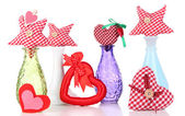 Hand-made textile hearts in different vases, isolated on white — Stock Photo