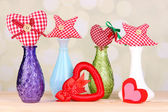 Hand-made textile hearts and stars on wooden table, on light background — Stock Photo