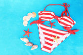 Swimsuit on color background — Stock Photo
