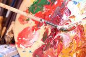 Artist paints picture close-up — Stock Photo