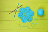 Blue yarn for knitting with napkin and spokes on wooden table close-up — Stock Photo