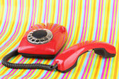Red retro telephone on bright background — 图库照片