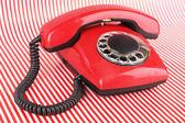 Red retro telephone on bright background — Stock fotografie