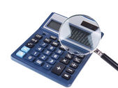 Fraud concept with magnifier and calculator, isolated on white — Stock Photo